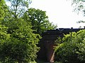 Steam train passing over a bridge - geograph.org.uk - 182720.jpg