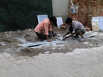 Occupational safety and health - Workers cutting marble without any protective gear, Indore, India