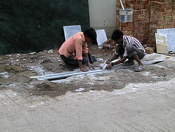 Workers cutting marble without any protective gear. Photo taken in Indore, India