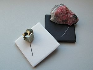 Streak (mineralogy) - Streak plates with pyrite (left) and rhodochrosite (right)