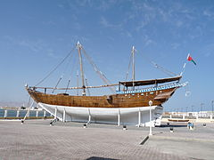 A picture of an Arabian dhow, a ship constructed with a covered area at the rear and no real superstructure. They are used as cargo vessels and have one or two masts with triangular sails.