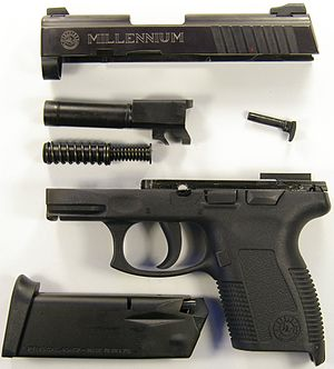 Taurus Millennium series - A Taurus PT145 that has been field stripped into the major components