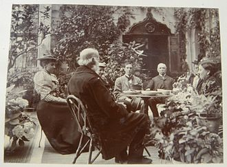 William Andrew Salius Fane de Salis - Tea in the conservatory at Teffont, Wiltshire, showing the back of the head of W. F. de Salis.