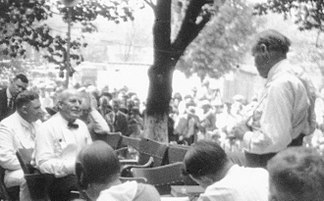 Tennessee v. John T. Scopes Trial- Outdoor proceedings on July 20, 1925, showing William Jennings Bryan and Clarence Darrow. (2 of 4 photos) (2898243103) crop.jpg