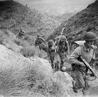 Mediterranean and Middle East theatre of World War II - Men of the 10th Battalion, Royal Berkshire Regiment, part of 168th Brigade of British 56th Division, climbing the heights of Calvi Risorta shortly after the invasion of Italy, October 1943.