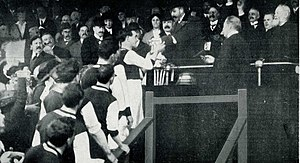 FA Cup - King George V presents the FA Cup trophy to Tommy Boyle of Burnley F.C., April 1914