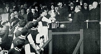 Burnley F.C. - King George V presents the 1914 FA Cup trophy to Burnley captain Tommy Boyle.