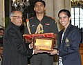 The President, Shri Pranab Mukherjee felicitates Ms. Saina Nehwal, the London Olympic Bronze Medal winner in Badminton, at a function, in New Delhi on August 18, 2012.jpg