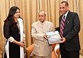 The President, Shri Pranab Mukherjee presenting a copy of a book on Rashtrapati Nilayam to the Governor of Andhra Pradesh and Telangana, Shri E.S.L. Narasimhan, at Rashtrapati Nilayam, Secunderabad on December 21, 2015.jpg