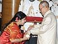 The President, Shri Pranab Mukherjee presenting the Padma Shri Award to Dr. Soma Ghosh, at a Civil Investiture Ceremony, at Rashtrapati Bhavan, in New Delhi on April 12, 2016.jpg