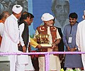 The Prime Minister, Shri Narendra Modi being presented the memento at the inauguration ceremony of the Amul Cheese Plant and Whey Drying Pant, in Palanpur, Banaskantha, Gujarat on December 10, 2016 (1).jpg