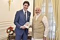 The Prime Minister, Shri Narendra Modi presents his book Exam Warriors to the Prime Minister of Canada, Mr. Justin Trudeau, at Hyderabad House, in New Delhi on February 23, 2018.jpg