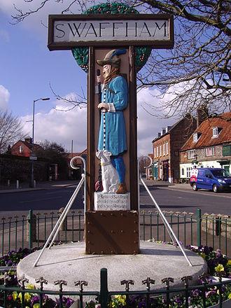 Pedlar of Swaffham - The Pedlar of Swaffham on a Swaffham town sign