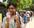The first time voter showing mark of indelible ink after casting her vote, at a polling booth, during the 9th Phase of General Elections-2014, under 16-Dum Dum PC, in West Bengal on May 12, 2014.jpg