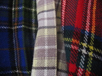 Tartan - Three tartans. Tartan is regarded as a cultural icon of Scotland