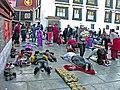 Tibet-5413 - Pilgrims preparing to enter. (2600765998).jpg