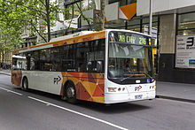 A Transdev Melbourne bus in orange and white PTV livery.