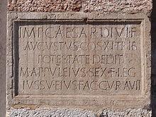 Lapide datata al 23 a.C. murata nella chiesa di Sant'Apollinare, con iscrizione che attesta l'esecuzione da parte di Marcus Appuleius di un'opera (non identificata) su comando dell'imperatore Augusto