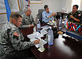 U.S. Air Force Gen. Douglas Fraser, commander of U.S. Southern Command, and Army Lt. Gen. Ken Keen, Joint Task Force-Haiti, meet with United Nations (UN) and UN Stabilization Mission in Haiti leaders at a UN 100306-N-HX866-008.jpg