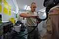 U.S. Air Force Staff Sgt. Josh Buckholtz, left, an aircrew flight equipment craftsman with the 493rd Expeditionary Fighter Squadron, checks for leaks in an oxygen mask used by aircrew personnel flying in fighter 110602-F-RH591-105.jpg