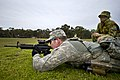 U.S. Army Staff Sgt. Aaron Paul, foreground, with the 2nd Brigade, 25th Infantry Division, fires at a 300-meter target as Australian army Pvt. Naomi Gangell, with the 10th Force Support Battalion, records his 120507-F-MQ656-032.jpg