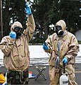 U.S. Soldiers of Bravo Company, 110th Chemical Battalion (Technical Escort), start the decontamination process during an evaluated mission simulation at a training site on Joint Base Lewis-McChord, Wash 120124-A-LI868-169.jpg
