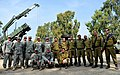 U.S. Soldiers with Bravo Battery, 5th Battalion, 7th Air Defense Artillery Regiment and Israeli soldiers pose for a photo during Austere Challenge 2012 in Hazor, Israel 121101-F-QW942-188.jpg