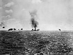 USS Lexington (CV-2) hit and burning during the Battle of the Coral Sea, 8 May 1942 (80-G-7414).jpg