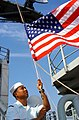 US Navy 000803-N-9109V-002 Ship lowers flag while preparing to enter port.jpg