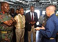 US Navy 030124-N-9867P-004 Commanding Officer Capt. David Prothero, from Virginia Beach, Va., discusses the ship's communications capabilities with visitors from Kenya.jpg