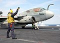 US Navy 030215-N-4154B-503 An Aviation Boatswain's Mate signals to an EA-6B Prowler assigned to the Scouts of Sea Control Squadron Two Four (VS-24).jpg