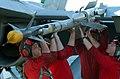 US Navy 030308-N-4655M-003 Aviation Ordnancemen install an air-to-air missile onto an F-A-18D Hornet on the flight deck of the aircraft carrier USS Constellation.jpg
