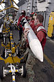 US Navy 030321-N-4308O-021 Aviation Ordnancemen work together to stage ordnance in the 'bomb farm' aboard USS Harry S. Truman (CVN 75).jpg