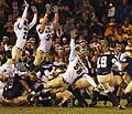 US Navy 031108-N-2899A-003 Navy defenders stretch out in an attempt to block Notre Dame's winning field goal.jpg