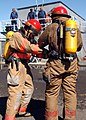 US Navy 040319-N-3019M-005 Two Sailors assigned to the guided missile cruiser USS Lake Erie (CG 70) dress out in full firefighting ensembles as part of the Damage Control Olympics held at Afloat Training Group, Middle Pacific a.jpg