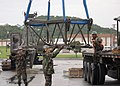 US Navy 040521-N-5704B-002 Seabees offload crane boom sections as they prepare for a crane certification test.jpg