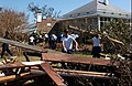 US Navy 040919-N-1810F-022 Students assigned to the Naval Air Technical Training Center (NATTC) on board Naval Air Station Pensacola, Fla., work together to clear debris left by Hurricane Ivan.jpg