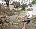 US Navy 040922-N-8267S-003 Officer Candidate School (OCS) Candidate Josh Williams, of La Grange, Texas, hauls a broken tree limb from a street on board Naval Air Station Pensacola, Fla.jpg
