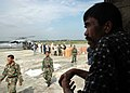 US Navy 050104-N-9293K-151 An Indonesian man waits for food and humanitarian relief at Sultan Iskandar Muda Air Force Base in Banda Aceh, Sumatra, Indonesia.jpg