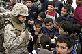 US Navy 050105-M-9015W-010 Navy Lt. Rasha Hanna, a Dental Officer from Steubenville, Ohio, interacts with Iraqi children during a Female Civil Affairs Mission to a school in Abu Tiban, Iraq.jpg