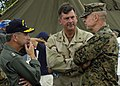 US Navy 050106-N-9951E-071 Rear Adm. Doug Crowder, left, and Rear Adm. Christopher C. Ames and Brig. Gen. Christian Cowdrey, talk about U.S. military members supporting the humanitarian relief efforts in Banda Aceh, Sumatra, I.jpg