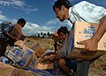 US Navy 050113-N-8629M-264 Tsunami victims anxiously grab relief supplies brought to them by a U.S. Navy MH-60S Knighthawk helicopter.jpg