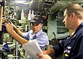 US Navy 050308-N-5539C-001 Machinist Mate 2nd Class Travis Massie, left, assigned to the Los Angeles-class attack submarine USS Tucson (SSN 770), received his submarine warfare pin in 30 days, a record aboard the boat.jpg