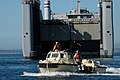 US Navy 050728-N-8268B-022 A Logistical Amphibious Recovery Craft (LARC) amphibious vehicle assigned to Beachmaster Unit One (BMU-1) launches from the Military Sealift Command (MSC) sea barge heavy lift ship SS Cape Mohican (T.jpg