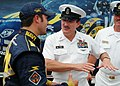 US Navy 050813-N-0962S-109 Master Chief Petty Officer of the Navy (MCPON) Terry Scott speaks with David Stremme prior to the NASCAR Busch Series Zippo 200 race at Watkins Glen International.jpg