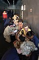 US Navy 050905-N-6436W-205 U.S. Navy Sailors help Hurricane Katrina victims fill out paperwork after being transported the dock landing ship USS Tortuga (LSD 46).jpg