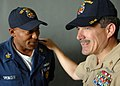 US Navy 050910-N-5345W-093 Master Chief Petty Officer of the Navy Terry Scott speaks with Navy Counselor 1st Class Ricardo Spencer shortly after coming aboard the dock landing ship USS Tortuga (LSD 46).jpg