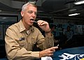 US Navy 060628-N-6645H-025 During the ship's Bone Marrow Drive and Health Expo, Capt. Todd A. Zecchin, commanding officer USS John F. Kennedy (CV 67), performs a Buccal Swab Collection procedure.jpg