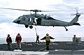 US Navy 070113-N-4420S-035 Aviation Boatswain's Mate (Handling) 3rd Class Jason Andres signals to a MH-60S Seahawk helicopter during a Vertical Replenishment (VERTREP) with the Military Sealift Command (MSC) ammunition ship USN.jpg