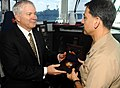 US Navy 070222-N-8923M-073 Secretary of Defense (SECDEF), the Honorable Dr. Robert M. Gates, presents his ceremonial coin to Commanding Officer Capt. Herman Shelanski on the bridge aboard USS Harry S. Truman (CVN 75).jpg